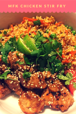 MFK Chicken Stir Fry : Marinated Chicken Thighs with Peanut , Sweet Sesame soy sauce comes with steamed brown rice mixed with carrots , peas and scallions